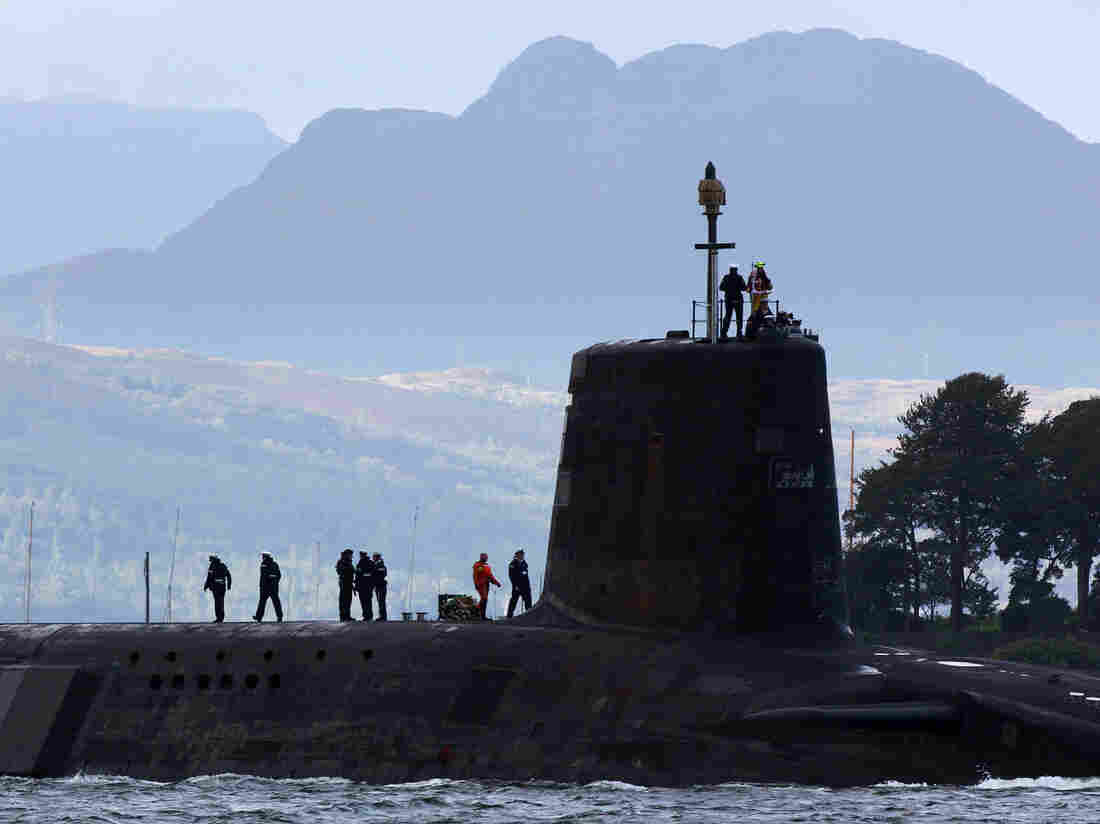 A Trident submarine makes its way out from Faslane naval base in 2009. Scotland votes on whether it wants independence next month, raising questions about the future of Britain's naval base, including its nuclear subs.