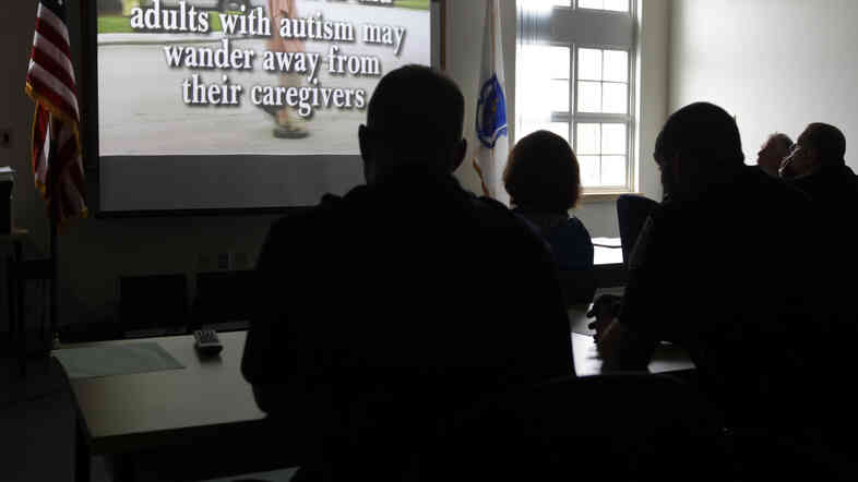 Police officers and other first responders attend a 2012 autism information training session in Wrentham, Mass. Several cities are working to reduce the risk of miscommunication between police officers and people with autism.