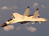 This handout photo provided by the Office of the Defense Secretary (OSD), taken Aug. 19, 2014, shows a Chinese fighter jet that the White House said Friday conducted a