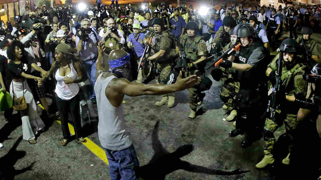 Police arrest a man as they disperse a protest Wednesday for Michael Brown, who was killed by police Aug. 9 in Ferguson, Mo.