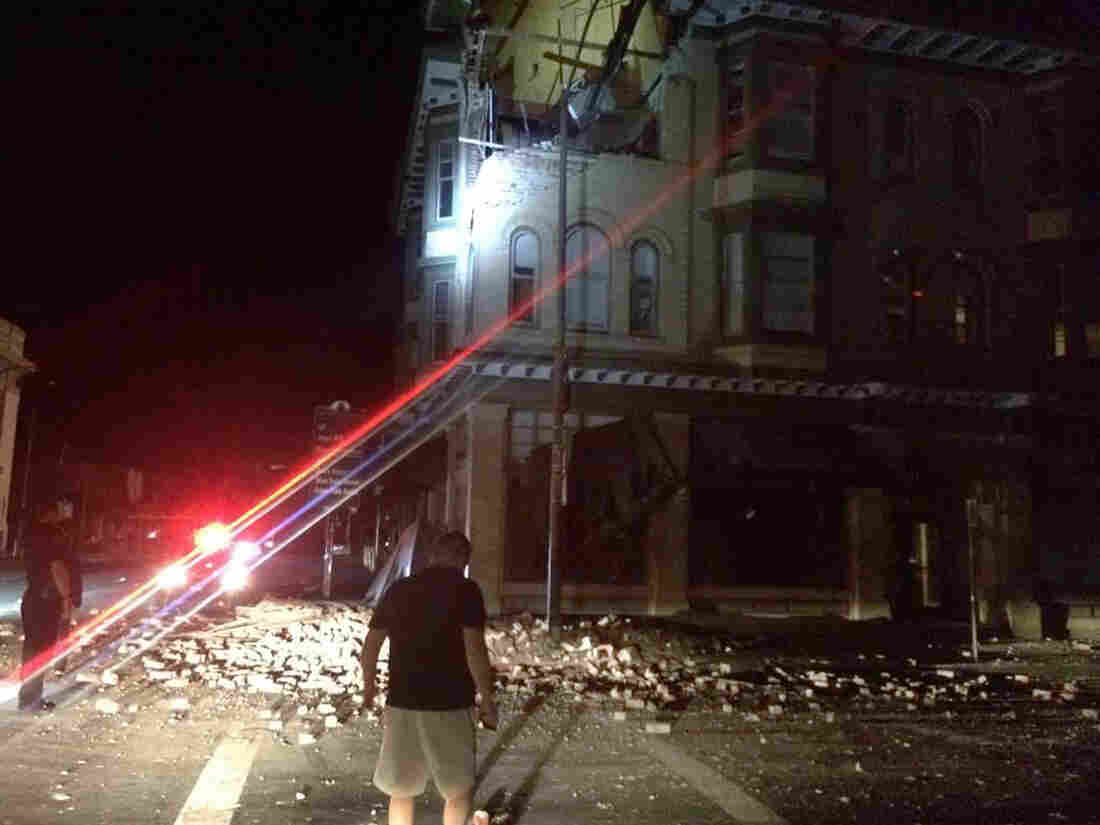 A photo provided by Lyall Davenport shows damage to a building in Napa, Calif., early Sunday.