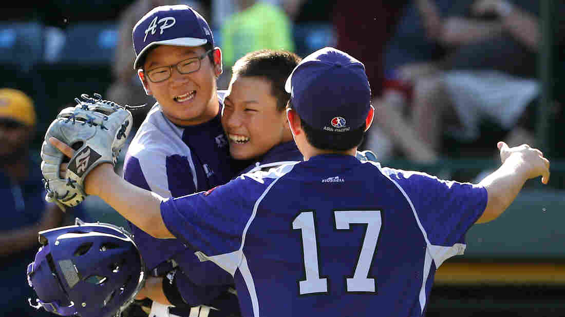 South Korea's Hae Chan Choi (left) celebrates with catcher Sang Hoon Han, center, and Shane Jaemin Kim (17) after getting the final out of a 8-4 win in the Little League World Series championship baseball game against Chicago in South Williamsport, Pa. on Sunday.