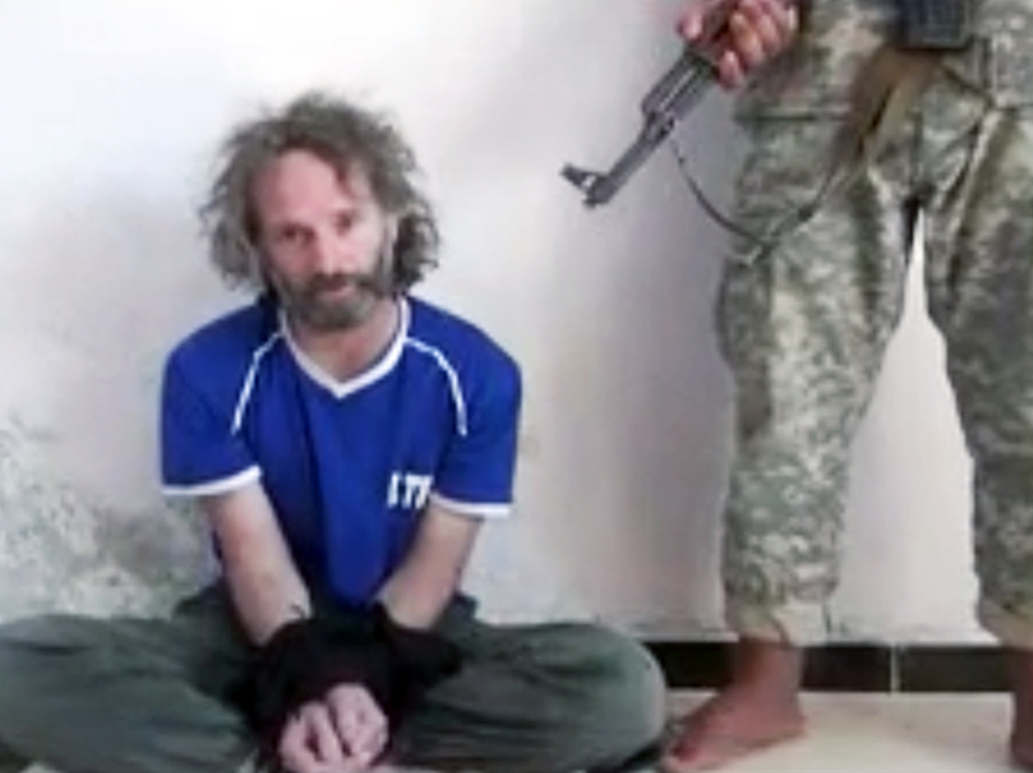 In this image made from undated video obtained by The Associated Press, a man believed to be Peter Theo Curtis, a U.S. citizen held hostage by an al-Qaida linked group in Syria, delivers a statement. (AP)