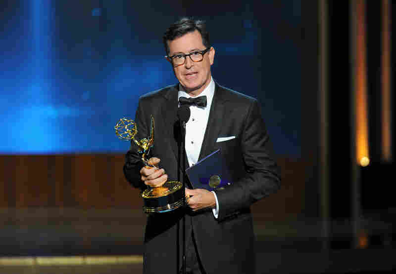 """Stephen Colbert accepts an award on behalf of Martin Freeman for his work on """"Sherlock. Colbert later won for best variety series for The Colbert Report, now in its last season on Comedy Central."""