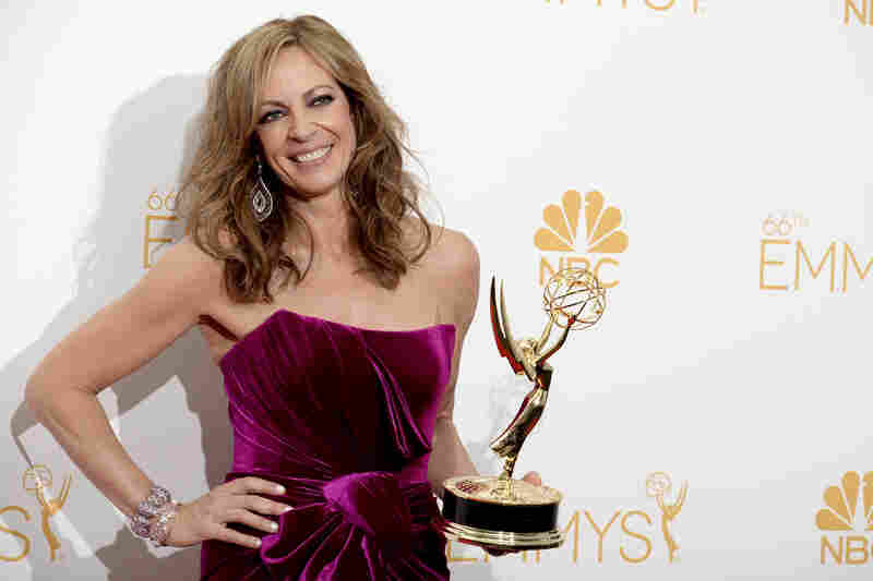 Allison Janney poses backstage with her Emmy for supporting actress in a comedy series for her role in Mom.