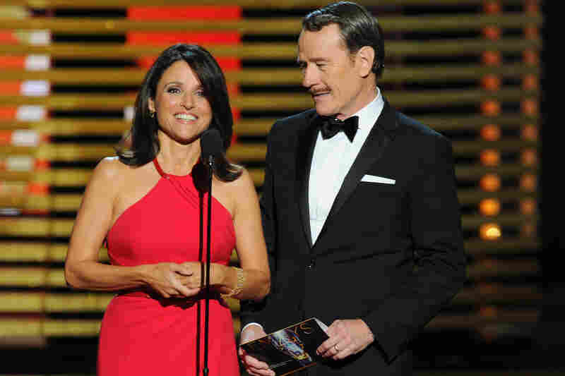 Julia Louis-Dreyfus and Bryan Cranston present the award for outstanding lead actor in a comedy series. Louis-Dreyfus later won the trophy for lead actress in a comedy series for Veep, and Cranston for best actor in a drama for Breaking Bad.