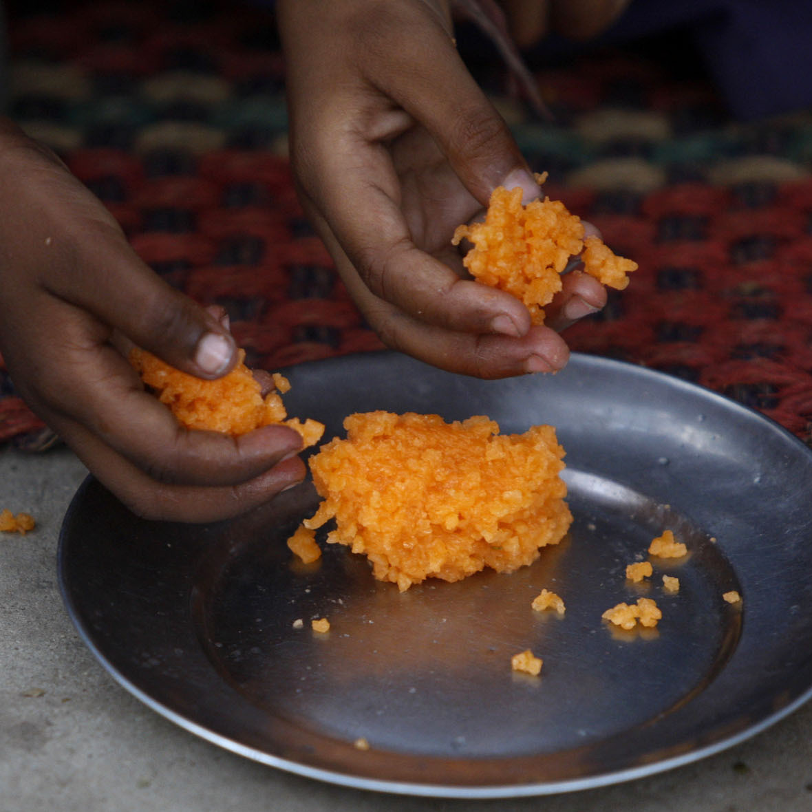 Sweetened rice is a popular dessertand snack in India. This dish, traditionally made with a pinch of saffron and cardamom powder, was served at a school on the outskirts of Jammu in northern India.