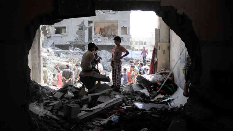 Palestinian boys at a damaged building in Rafah, the Gaza Strip, on Thursday. U.S. attempts to broker a comprehensive peace deal have again been shelved as Israel and Hamas have waged their third round of heavy fighting in Gaza in the past six years.