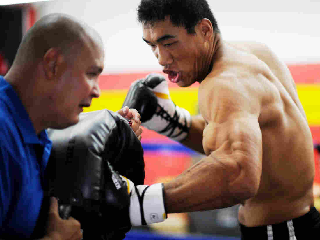 Taishan Dong works with coach John Bray at the Glendale Fighting Club, north of Los Angeles. At
