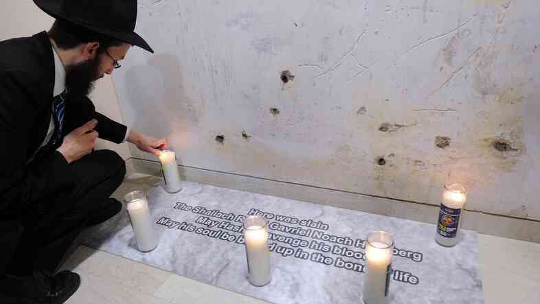 Rabbi Israel Kozlovsky, the new director of Nariman House in Mumbai, lights a candle Tuesday at the spot where his predecessor, Rabbi Gavriel Holtzberg, was killed during a 2008 attack.