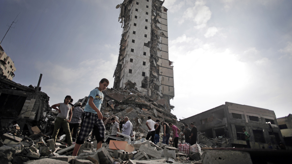 Palestinians inspect the damage to the Italian Complex following several late-night Israeli airstrikes in Gaza City on Tuesday.
