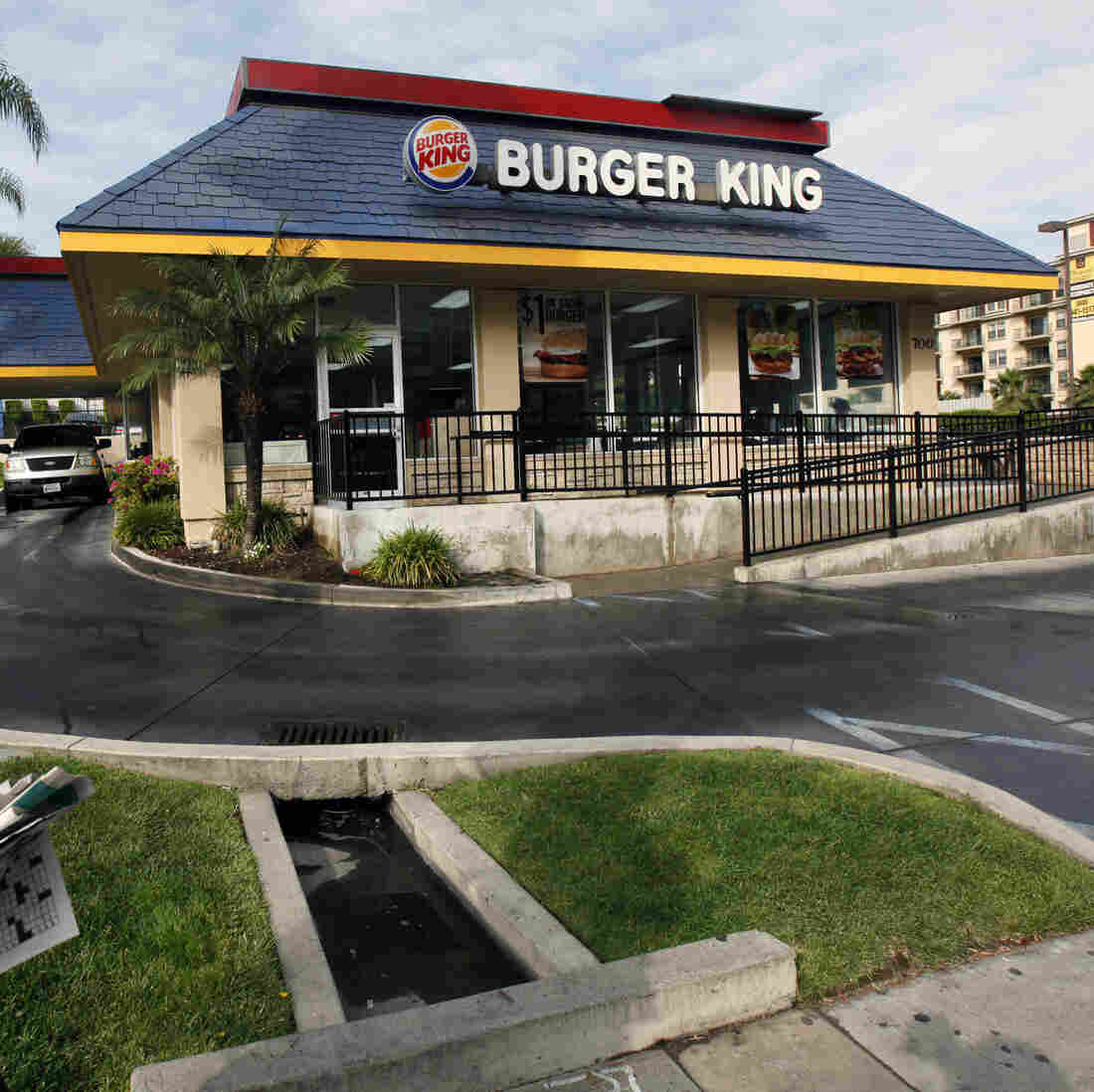 A pedestrian walks past a Burger King restaurant near downtown Los Angeles.