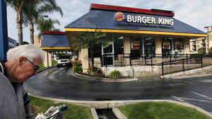 A pedestrian walks past a Burger King restaurant near downtown Los Angeles.