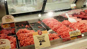 Meat is displayed in a case at a grocery store in Miami in July. Pork and beef prices are up more than 11 percent since last summer.