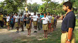 The RSS, the ideological source of Hindu nationalism, practices dawn drills in a suburban Delhi park. Volunteers rehearse calisthenics, sing patriotic songs and salute their saffron flag as part of their pledge to protect India against potential dangers.