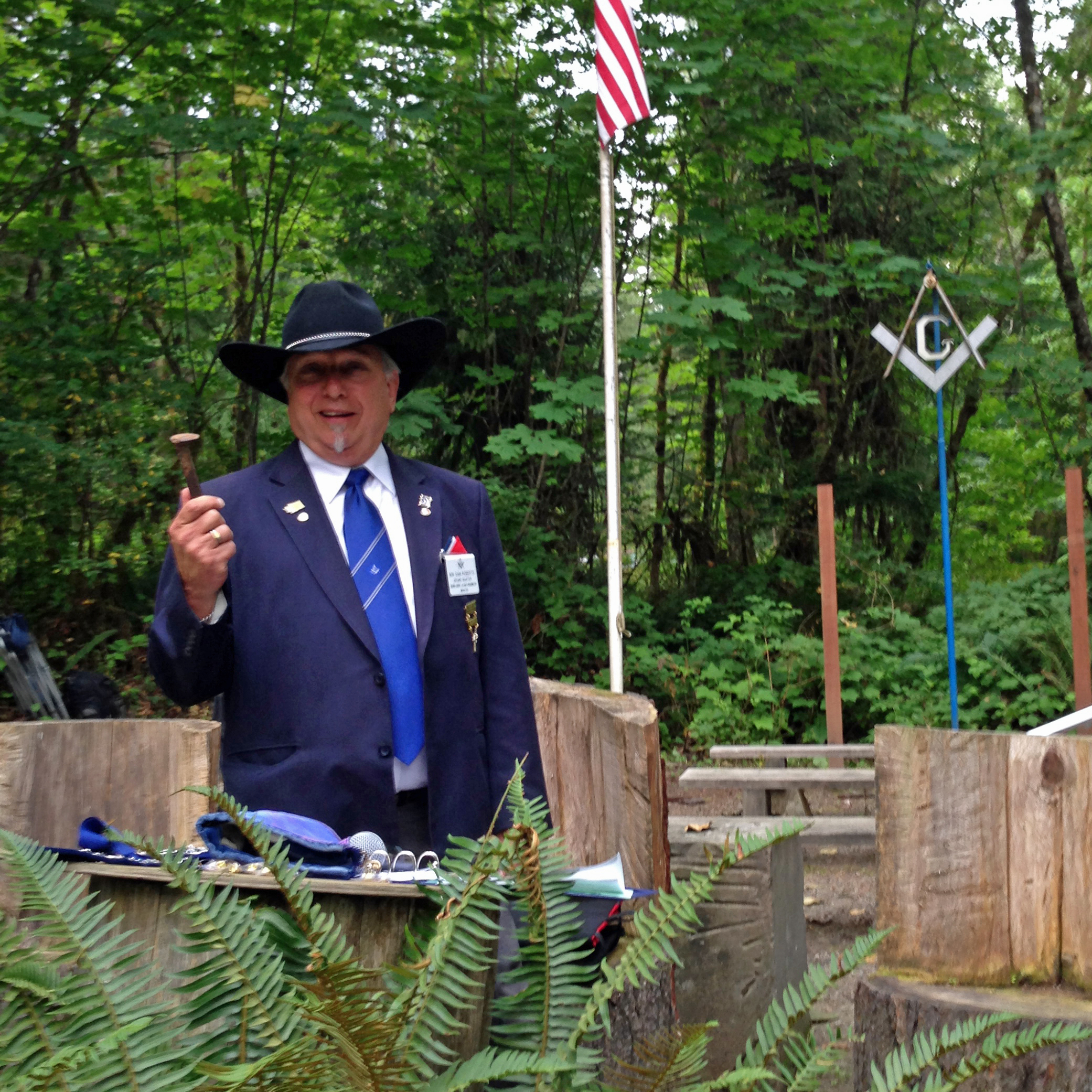 Sam Roberts, most worshipful grand master of Washington state, presides over an outdoor ceremony. His wife, Vicky, says she doesn't mind that women can't participate in the Masons' ceremonies.