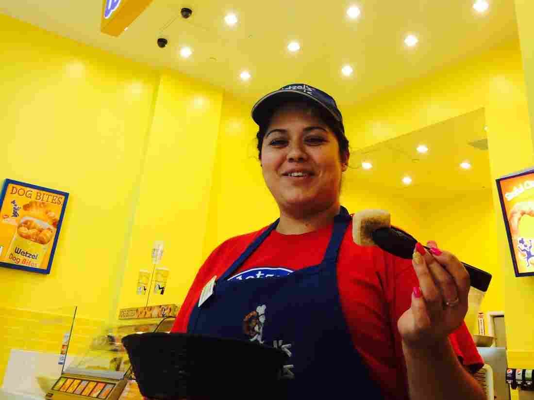 Wetzel's Pretzels employee Emperatriz Orozco hands out free samples at the Westfield Valley Fair Mall.