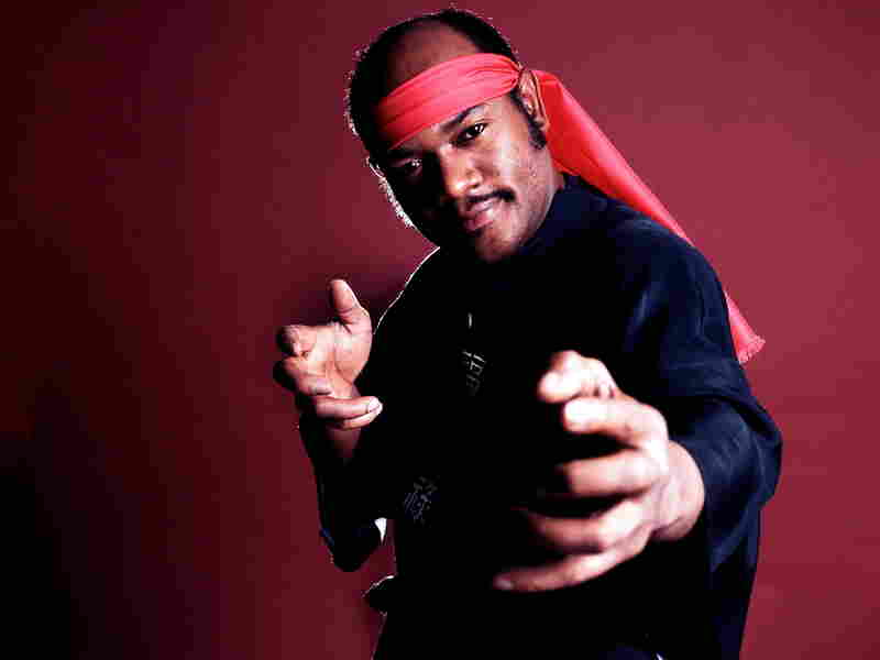 """Carl Douglas strikes a pose as he promotes his 1974 song, """"Kung Fu Fighting."""""""