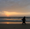 A Sri Lankan beachgoer walks during sunset in Colombo on Jan. 30, 2014.