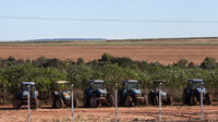 Tractors sit on a sugarcane plantation on the land of a Guarani-Kaiowá indigenous community in Brazil, where Oxfam has alleged