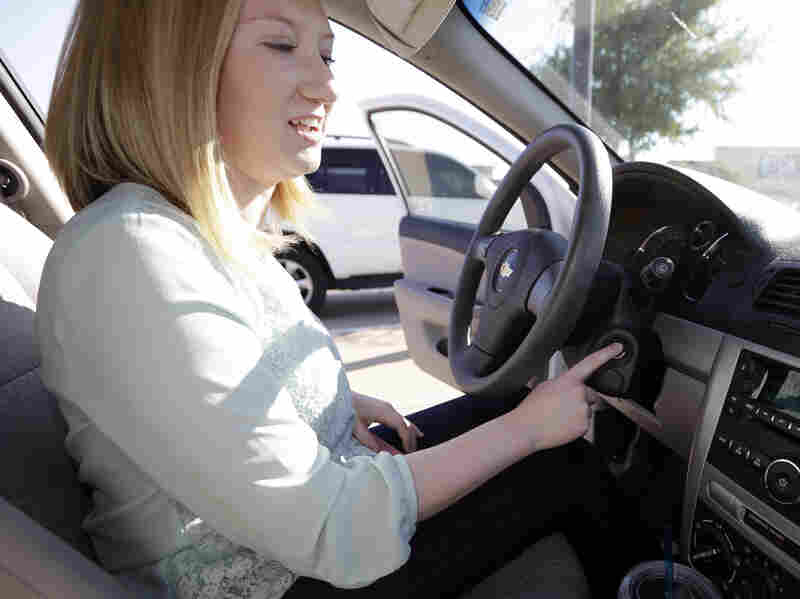 Wendi Kunkel points out the key in the ignition on her 2010 Chevy Cobalt in Rockwall, Texas, in April. GM recalled millions of cars over a flaw in ignition switches that could cause the vehicles to shut off unexpectedly.
