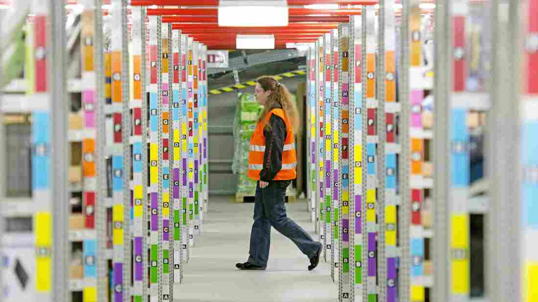 An employee walks in an Amazon distribution center in Leipzig, Germany, in March.