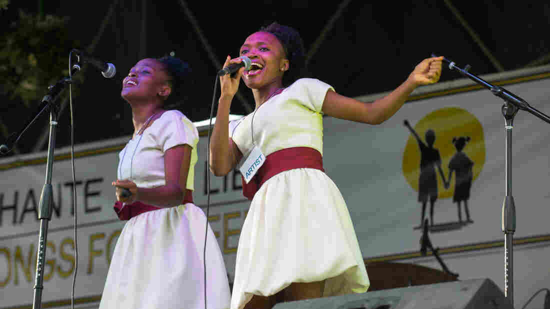 """Frantzita Dede, who's 19, sings """"Let's Help Them"""" — the child slaves of Haiti."""