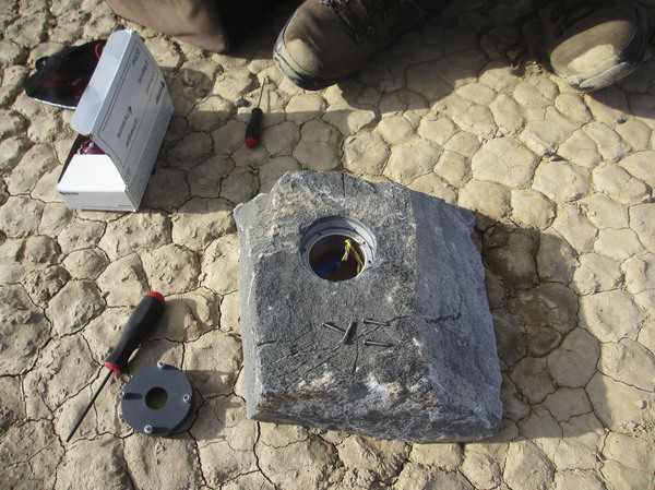 The cavity in this rock will carry the GPS instrument package and its battery pack across the desert.