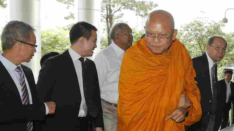Suthep Thaugsuban, a former deputy prime minister who ordered a bloody crackdown on protesters in 2010 and later encouraged a coup against the elected government, arrives at court on Thursday. In recent weeks, Suthep has become a Buddhist monk.