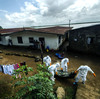 A team of body collectors carry the corpse of a woman suspected of dying of Ebola in Monrovia, Liberia's capital.