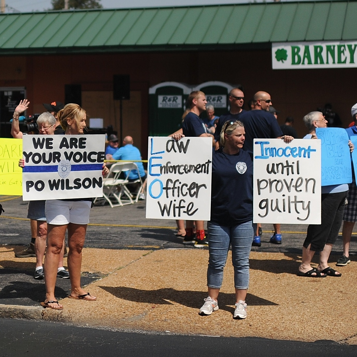 Protesters rally in support of Darren Wilson, the Ferguson police officer who shot Brown. Supporters have raised more than $400,000 for Wilson.