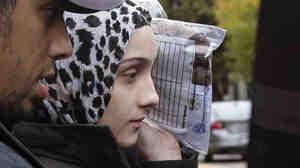 Ailiana Tsarnaeva, sister of Boston Marathon bombing suspect Dzhokhar Tsarnaev, departs district court in Boston's South Boston neighborhood in October.