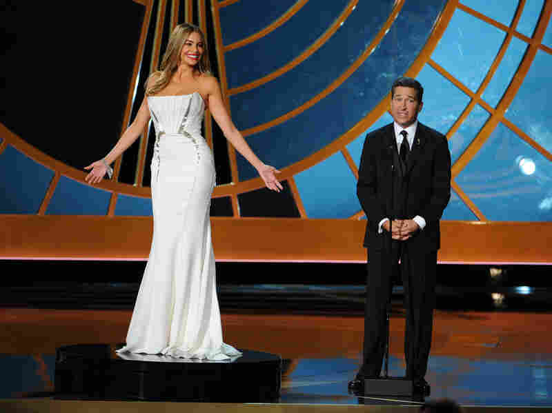 Sofía Vergara and Television Academy CEO Bruce Rosenblum enact the notorious pedestal stunt at the 2014 Emmy Awards.