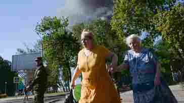 Women rush across the street after shelling in the town of Donetsk, Ukraine on Wednesday.