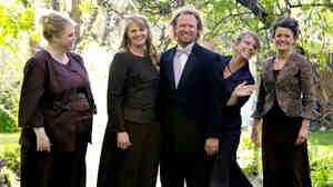 Kody Brown poses with his wives (from left) Janelle, Christine, Meri and Robyn in a promotional photo for TLC's reality TV show Sister Wives.