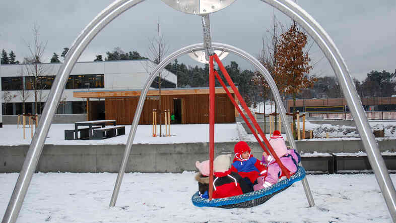 This photo of children playing outside at a day care center in Norway appeared on the NPR.org version of the GlobalPost story.