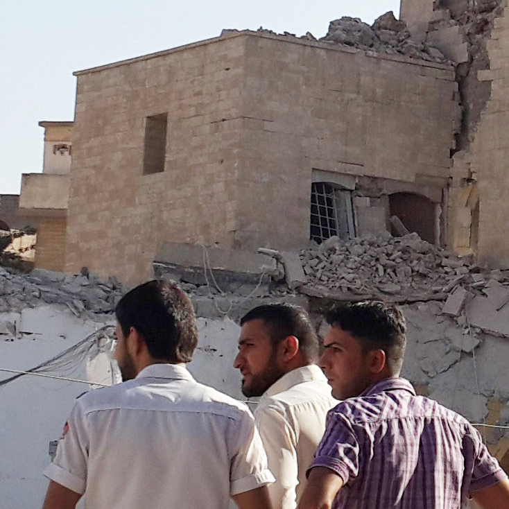 People inspect the remains of a destroyed mosque in Mosul on July 27.