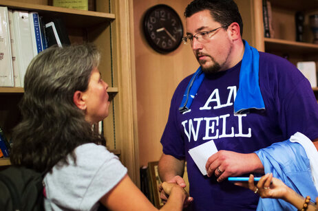 "Corinna Anjali (left) speaks to Mayor Knowles after the event. ""You're in the hot spot as the one person in power,"" Anjali said to Knowles. ""It's important for you to say 'I hear you' to the people who have been hurt."""