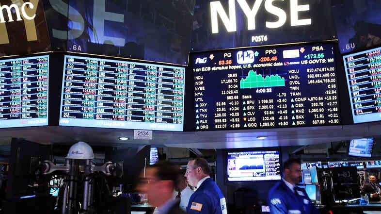 Traders work on the floor of the New York Stock Exchange last week in New York City.