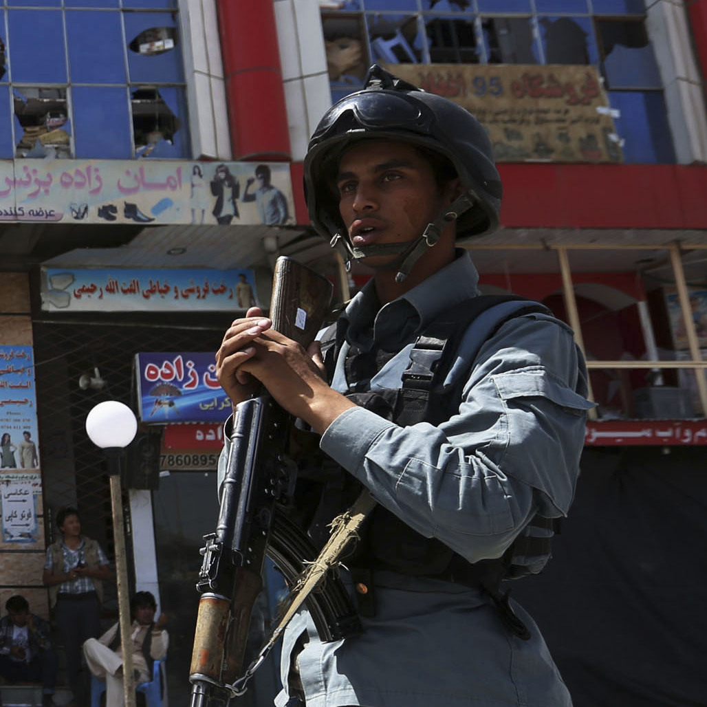 Afghan policemen keep watch at the site of a suicide car bomb attack in Kabul on Aug. 10. Four civilians were killed. It's not clear whether the Afghan security forces will be able to keep the Taliban in check after U.S. and NATO combat forces leave at the end of the year.