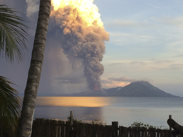 Smoke billows from Mount Tavurvur after an eruption in Kokopo, east New Britain, Papua New Guinea, on Friday. The eruption has caused some nearby residents to be evacuated and some flights to be rerouted.