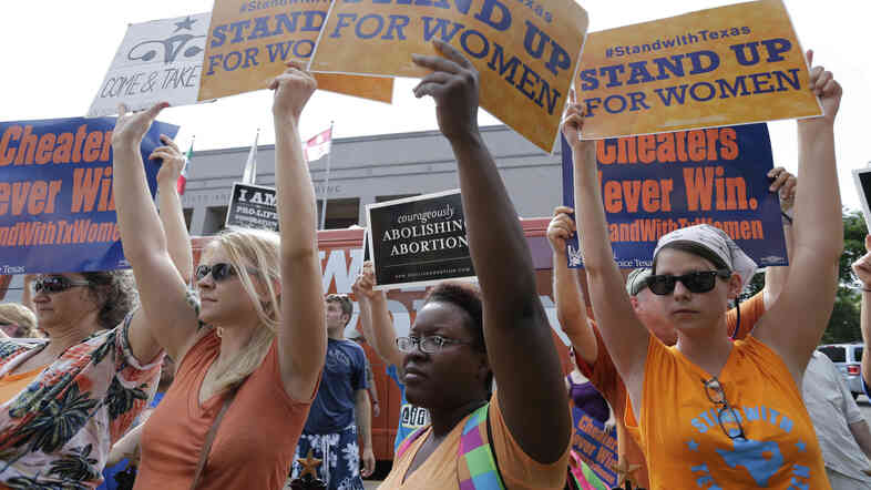 Opponents and supporters of a law that restricts abortion in Texas rallied outside the Texas Capitol in Austin as the bill was debated in July 2013.
