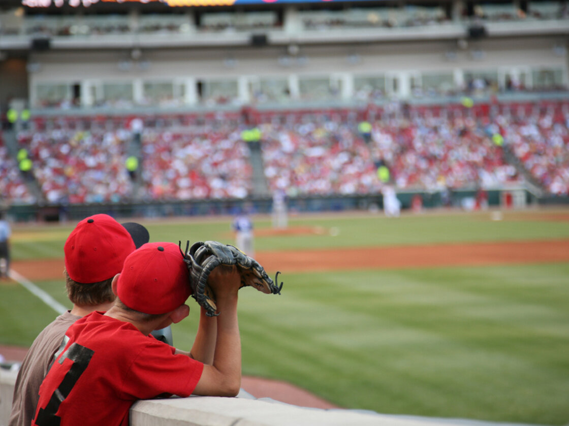 Two young boys at a Cincinnati Reds game.