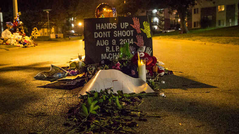A memorial at the site where Michael Brown was shot, on Canfield Drive in Ferguson, Mo.