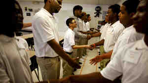 Ninth-graders at George Washington Carver Collegiate Academy learn to shake hands and greet each other during the first day of school in New Orleans.