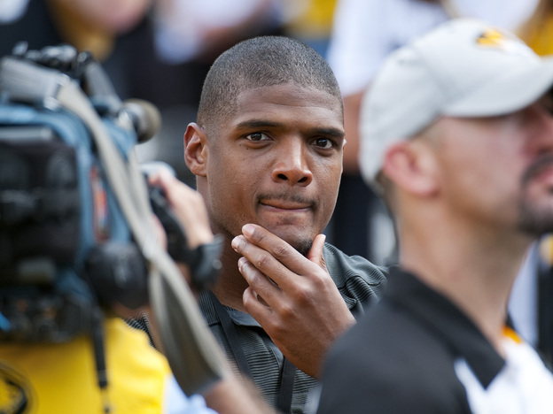 St. Louis Rams draft pick Michael Sam watches pregame festivities before the start of the South Dakota State-Missouri NCAA college football game on Saturday, in Columbia, Mo. Sam, the first openly gay player drafted by an NFL team, was released by the St. Louis Rams Saturday.