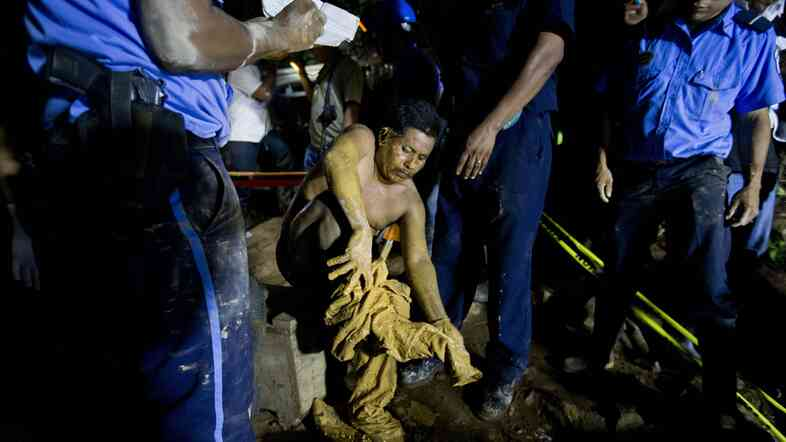 A miner after he was rescued at the El Comal gold and silver mine in Bonanza, Nicaragua, on Friday. A total of 26 were trapped after a collapse on Thursday.