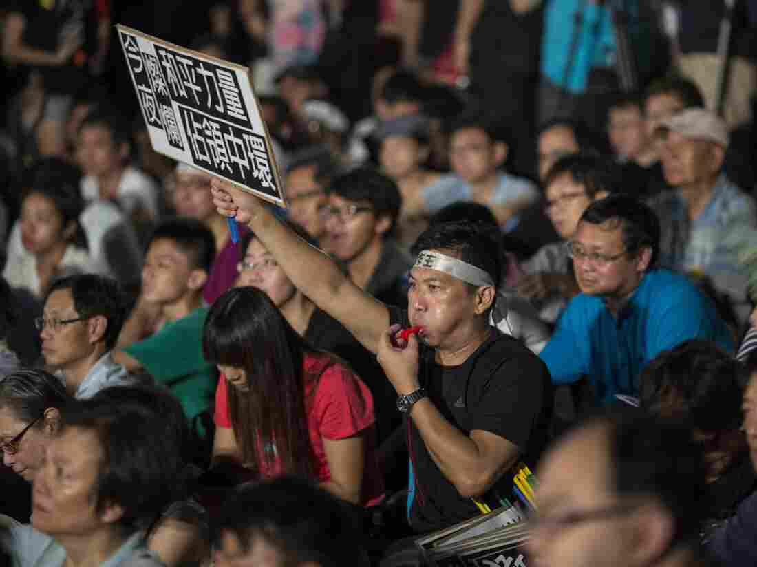 Protesters attend a rally organized by the Occupy Central with Love and Peace movement outside the Chief Executive office in Hong Kong, China, on Sunday.