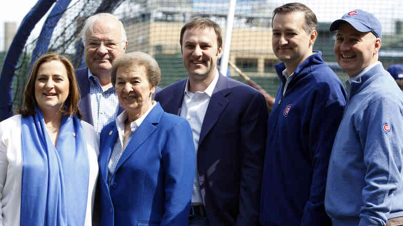 The Ricketts family poses on the Chicago Cubs field in 2010, a year after they bought the team. From left, Laura Ricketts, Joe Ricketts, Marlene Ricketts, Todd Ricketts, Tom Ricketts and Pete Ricketts.