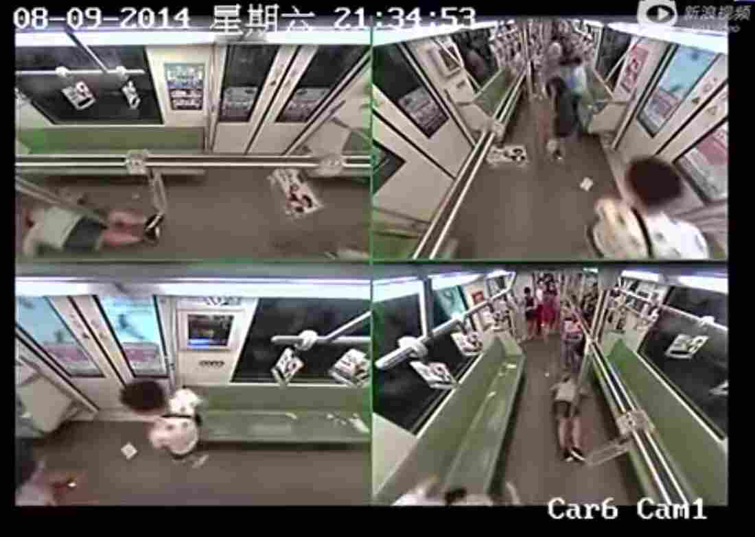 A still from the surveillance camera footage shows the fainting man (top left and bottom right) lying alone in a subway car, as the few remaining occupants hurry away.